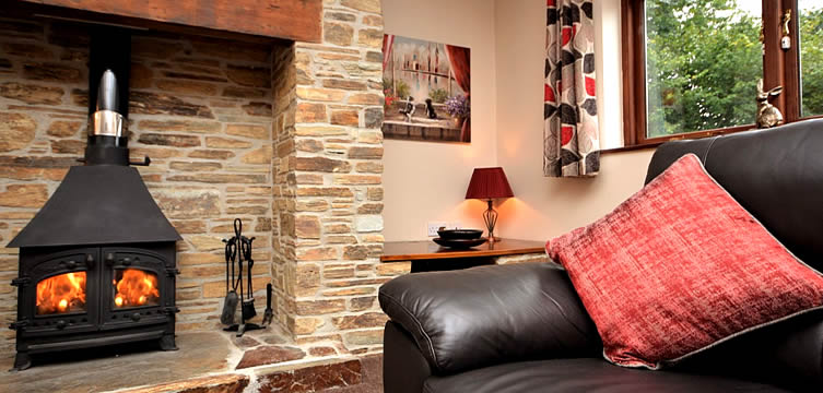 Comfortable lounge with woodburning stove in Bramble Cottage